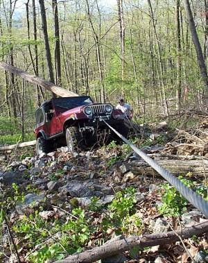 Mike Winching his CJ-7 up a steep hill.
